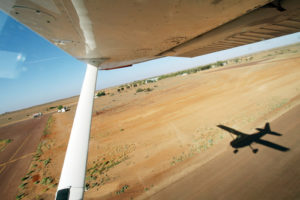 Light Aircraft Cessna taking off runway Outback Australia